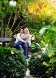 Loving couple on a bench in autumn park Stock Image