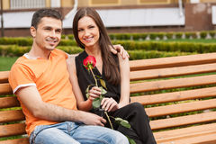 Loving couple on the bench. Stock Photos
