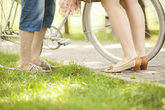 Loving couple with bicycle. Loving couple in a park with a bicycle Royalty Free Stock Image