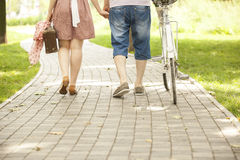 Loving couple with bicycle. Loving couple in a park with a bicycle Royalty Free Stock Photo