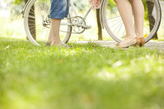 Loving couple with bicycle. Loving couple in a park with a bicycle Stock Images