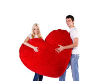 Loving couple with a big heart Royalty Free Stock Image