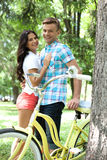 Loving couple with bike. Stock Images