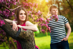Loving couple in the blossoming apple orchard Stock Photo