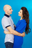 Loving couple on a blue background Royalty Free Stock Photos