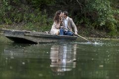Loving couple in the boat Stock Photos