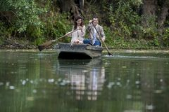 Loving couple in the boat Stock Photography