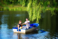 Loving couple in the boat. Summer vacation concept. Royalty Free Stock Image