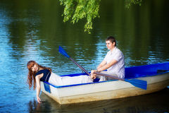 Loving couple in the boat. Summer vacation concept. Stock Photo