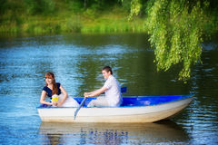 Loving couple in the boat. Summer vacation concept. Stock Image