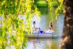 Loving couple in the boat. Summer vacation concept. Royalty Free Stock Photos