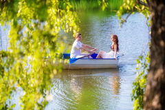 Loving couple in the boat. Summer vacation concept. Stock Photography