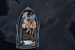 Loving couple in boat. royalty free stock photos