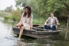 Loving couple in the boat Stock Photo