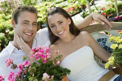 Loving Couple At Botanical Garden Royalty Free Stock Photos