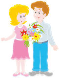 Loving couple with a bouquet of flowers. Vector illustration of a smiling young man and a young woman holding a bouquet of flowers, on a white background Stock Photography