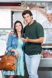 Loving Couple In Butchery Royalty Free Stock Photos