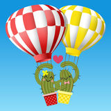 Loving couple of cactus arm in arm with hot air balloon Stock Photography