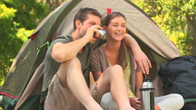 Loving couple camping in the country side stock video footage