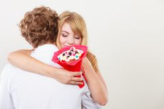 Couple with candy bunch flowers hugging. Love. Stock Photography