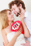 Loving couple with candy bunch flowers. Love. Stock Photography