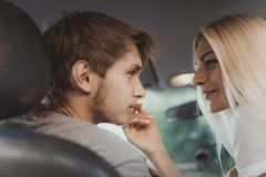 Loving couple in car Royalty Free Stock Image