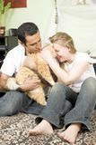 Loving couple with cat Royalty Free Stock Photo