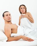 Loving couple caught in bed Royalty Free Stock Photo
