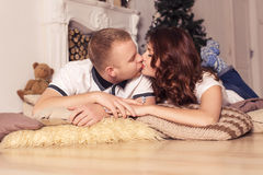 Loving couple celebrating christmas and new year at home sitting Royalty Free Stock Image