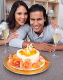 Loving couple celebrating in the kitchen Stock Images