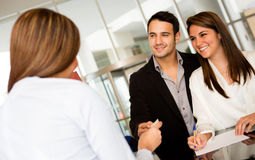 Loving couple checking in a hotel Stock Image