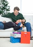 Loving Couple With Christmas Gifts Relaxing At Royalty Free Stock Image