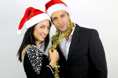 Loving couple for Christmas. On a white background royalty free stock image