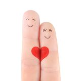 Loving couple concept with red heart, painted at fingers Royalty Free Stock Photos