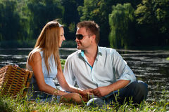 Loving couple confess in love. On the river shore Stock Images