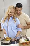 Loving couple cooking together royalty free stock image