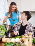 Loving couple cooking together Stock Image