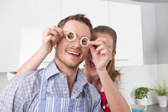 Loving couple cooking together in the kitchen Stock Photos