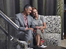 Loving Couple On Couch With Drinks In Hotel Lobby Royalty Free Stock Photography
