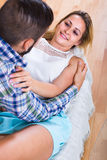 Loving couple on couch Royalty Free Stock Photos
