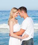 Loving couple cuddling at the beach Stock Image