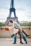 Loving couple dancing near the Eiffel Tower in Paris. Lovers dancing in Paris with the Eiffel Tower in the Background Royalty Free Stock Image