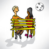 Loving couple on a date on a bench in moonlight Stock Images