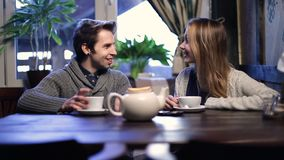 Loving couple on a date drinking tea at restaurant stock video