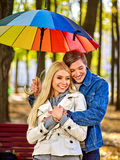 Loving couple on a date under umbrella stock photo