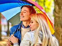 Loving couple on a date under umbrella Royalty Free Stock Image