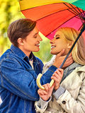 Loving couple on a date under umbrella Royalty Free Stock Photography