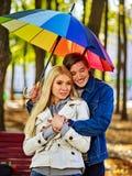 Loving couple a date under umbrella. Soft after rain. Stock Photo