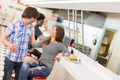 Loving couple in diner. View of the young couple eating in the diner Royalty Free Stock Image