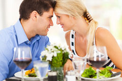 Loving couple dining. Loving young couple dining out in restaurant Royalty Free Stock Photo